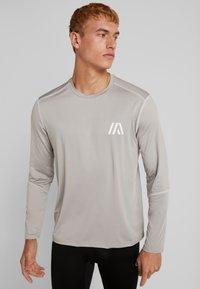 Your Turn Active - Langærmede T-shirts - mottled light grey - 0