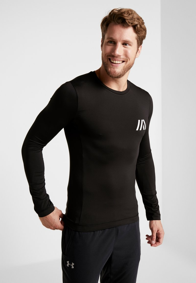 Your Turn Active - Long sleeved top - black