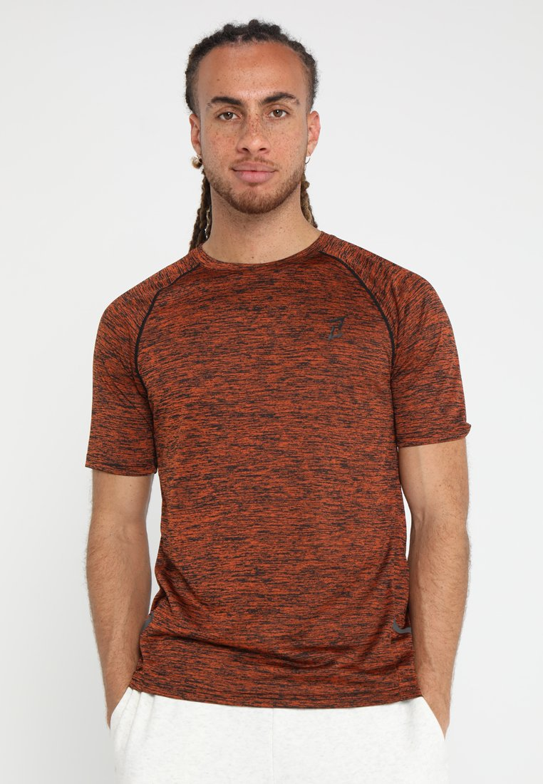Your Turn Active - Print T-shirt - mottled orange