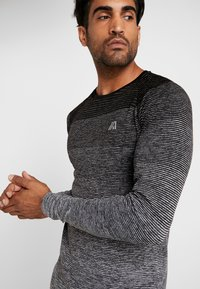 Your Turn Active - T-shirt sportiva - mottled grey - 4