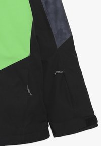 Ziener - AVAN JUNIOR - Ski jacket - black/green - 2