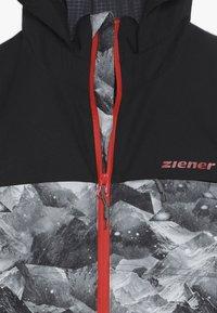 Ziener - ALIAM JUNIOR - Chaqueta de esquí - black - 4