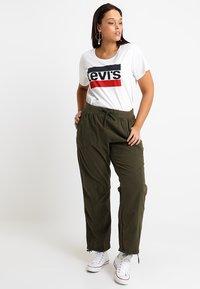 Zizzi - MMARRAKESH LONG PANT - Trousers - ivy green - 1
