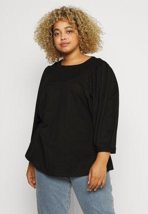 XAMANDA - Langærmede T-shirts - black