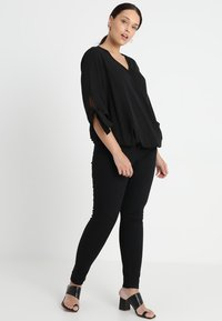 Zizzi - LONG AMY - Slim fit jeans - black - 1