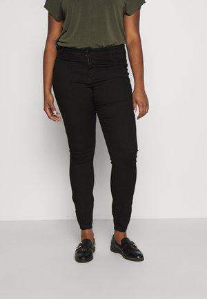 JANNA - Trousers - black