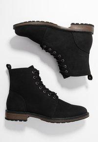 Zalando Essentials - Šněrovací kotníkové boty - black - 1