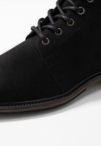Zalando Essentials - Šněrovací kotníkové boty - black - 5