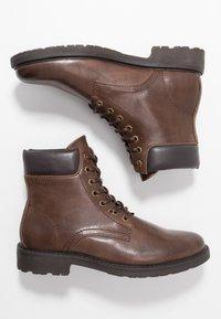Zalando Essentials - Lace-up ankle boots - dark brown - 1