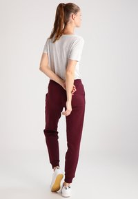Zalando Essentials - Tracksuit bottoms - port royale - 2