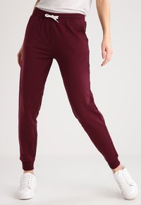 Zalando Essentials - Tracksuit bottoms - port royale - 0