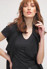 Zalando Essentials - 2 PACK - T-shirt basique - black/white - 4