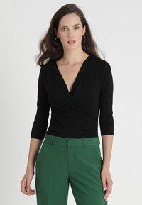 Zalando Essentials - T-shirt à manches longues - black - 0
