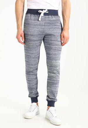 Teplákové kalhoty - mottled light blue