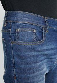 Zalando Essentials - Jeans slim fit - blue denim - 6