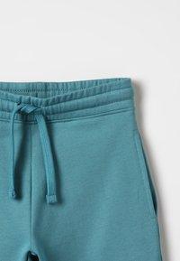 Zalando Essentials Kids - Tracksuit bottoms - brittany blue - 3