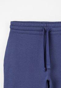 Zalando Essentials Kids - Tracksuit bottoms - crown blue - 5
