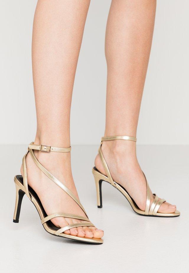 Højhælede sandaletter / Højhælede sandaler - gold