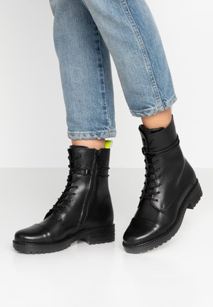 Lace-up ankle boots - yellow/black