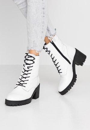 Botas para la nieve - white