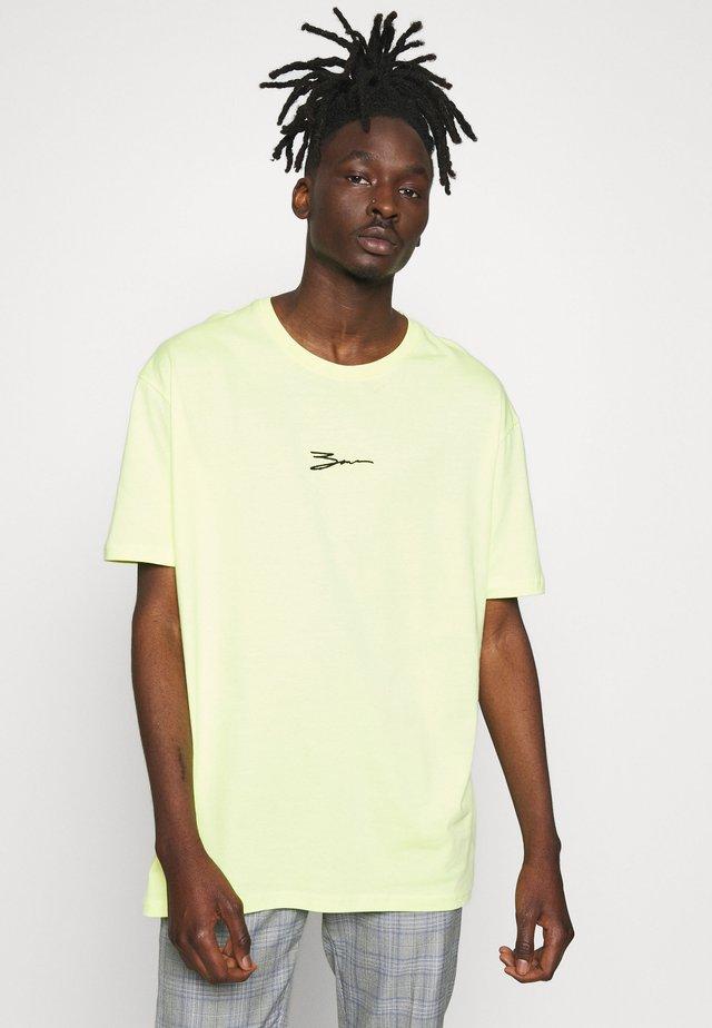 T-shirt z nadrukiem - neon green