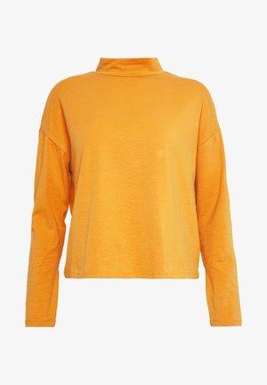 Langarmshirt - inca gold
