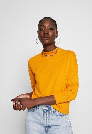 Maglietta a manica lunga - inca gold