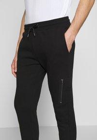 Zign - JOGGER - Teplákové kalhoty - black - 4