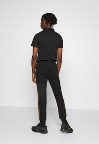 Zign - Spodnie treningowe - black - 2