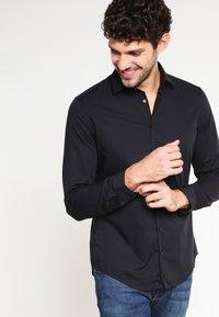 Seidensticker - Overhemd - schwarz - 0