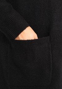 Zalando Essentials Curvy - Chaqueta de punto - black - 4