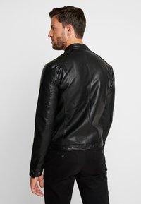 Produkt - PKTDLN DYLAN BIKER JACKET - Faux leather jacket - black - 2