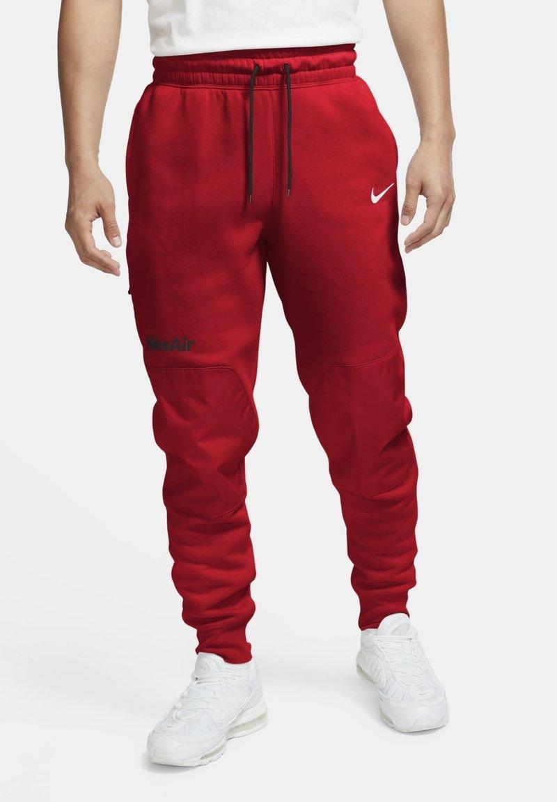 Nike Sportswear - FLEECEBYXOR - Tracksuit bottoms - black university red white
