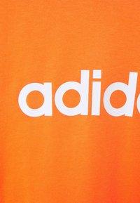 adidas Performance - Camiseta estampada - true orange - 6