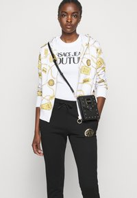 Versace Jeans Couture - Tracksuit bottoms - black/gold - 4