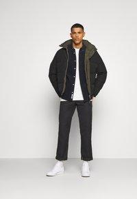 AllSaints - NOVERN JACKET - Down jacket - black - 1