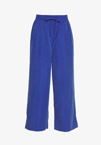 TAVI TROUSERS - Trousers - blue