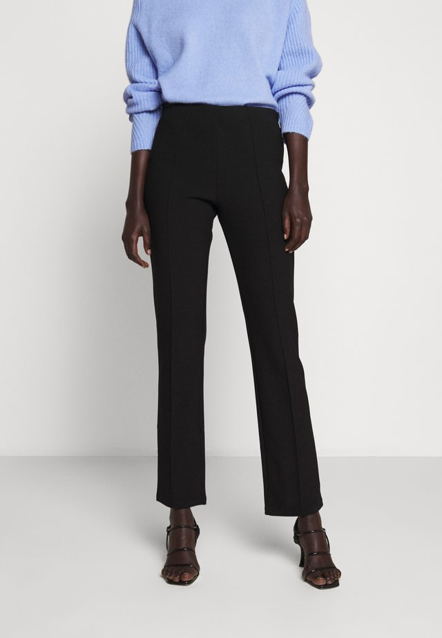 CHRISTAH - Trousers - black