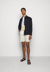 Emporio Armani - BERMUDA - Denim shorts - white - 1