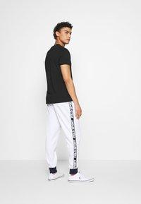 Polo Ralph Lauren - Træningsbukser - pure white - 2