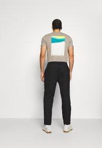 The North Face - CLASS PANT - Pantalon de survêtement - black - 2