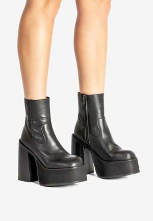 THROWBACK - High heeled ankle boots - black