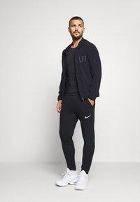 Calvin Klein Performance - WINDJACKET - Sportovní bunda - black - 1