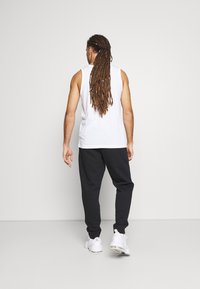 Calvin Klein Performance - PANTS - Pantaloni sportivi - black - 2
