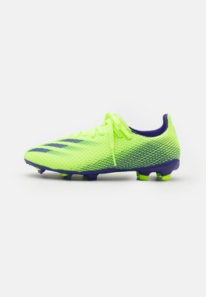 X GHOSTED.3 FG UNISEX - Moulded stud football boots - signal green/energy ink