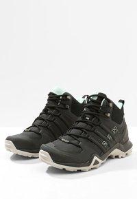 adidas Performance - TERREX SWIFT R2 MID GORE-TEX - Hiking shoes - core black/ash green - 2
