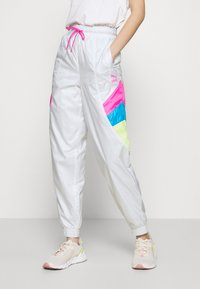 Puma - TRACK PANT - Tracksuit bottoms - white - 0