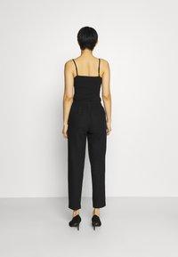 Marks & Spencer London - TAPERED - Trousers - black - 2