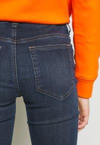 Diesel - D-SLANDY-B - Bootcut jeans - indigo - 6
