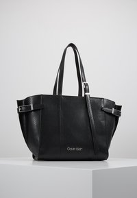 Calvin Klein - WINGED MED - Handbag - black - 0